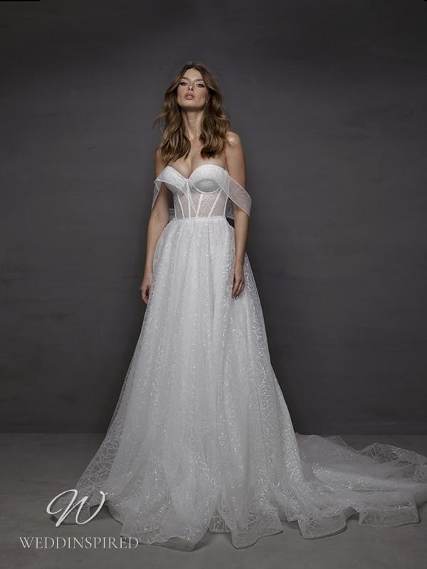 A Riki Dalal 2021 off the shoulder sparkly tulle A-line wedding dres