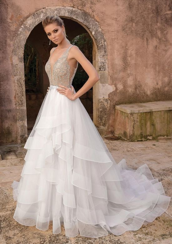 A Justin Alexander A-line wedding dress with a layered chiffon skirt and a deep v neckline with crystals