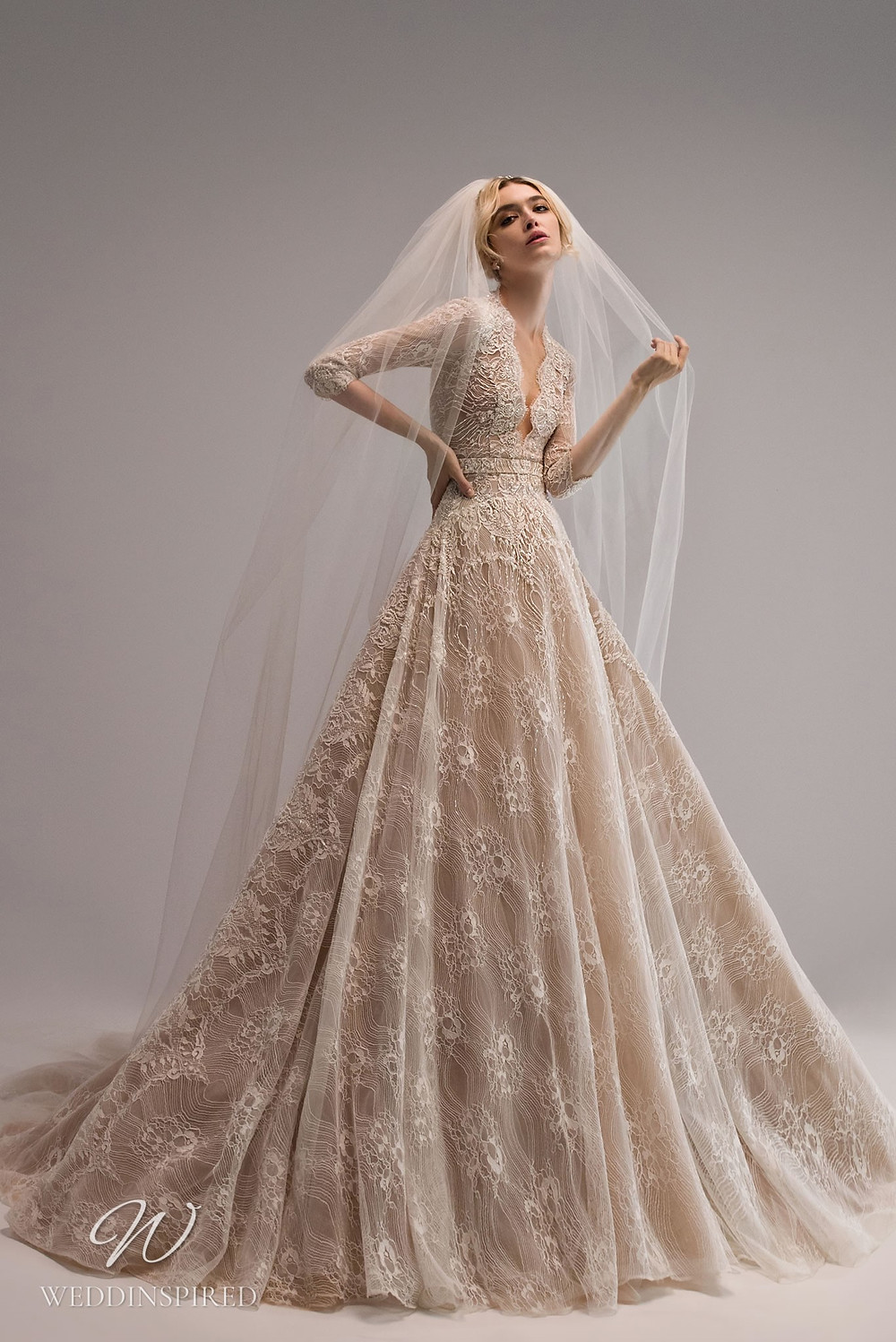 An Ersa Atelier 2021 blush lace ball gown wedding dress with half sleeves