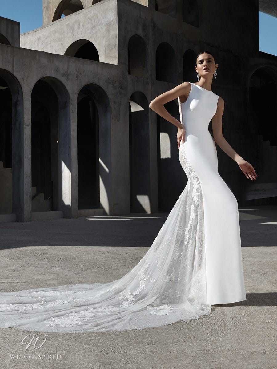 An Atelier Pronovias modest mermaid wedding dress with a high neck, lace and a long train