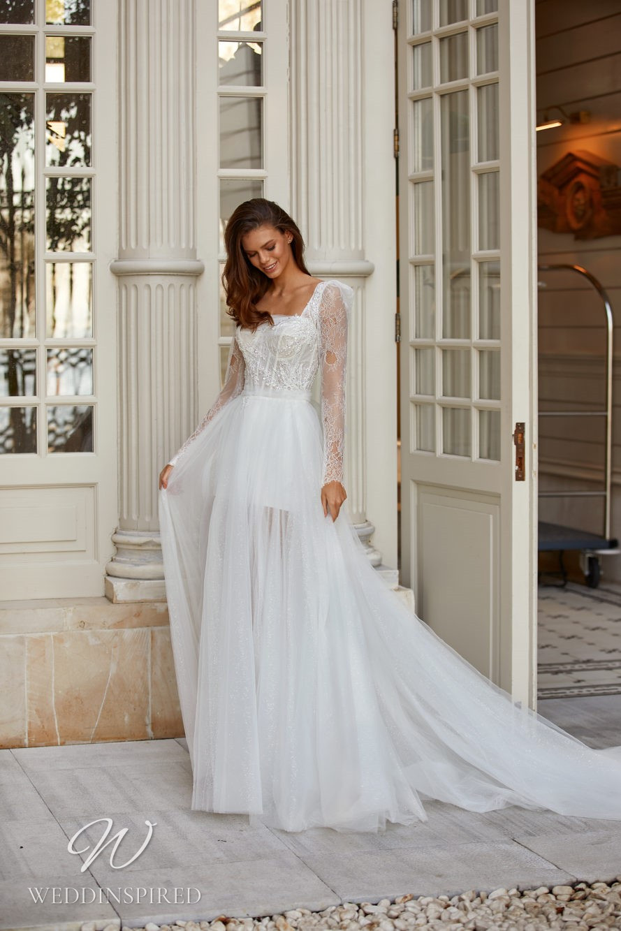 A Milla Nova 2021 lace and tulle A-line wedding dress with long sleeves