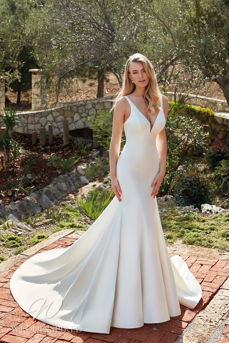 An Eddy K 2022 satin mermaid wedding dress with a v neck