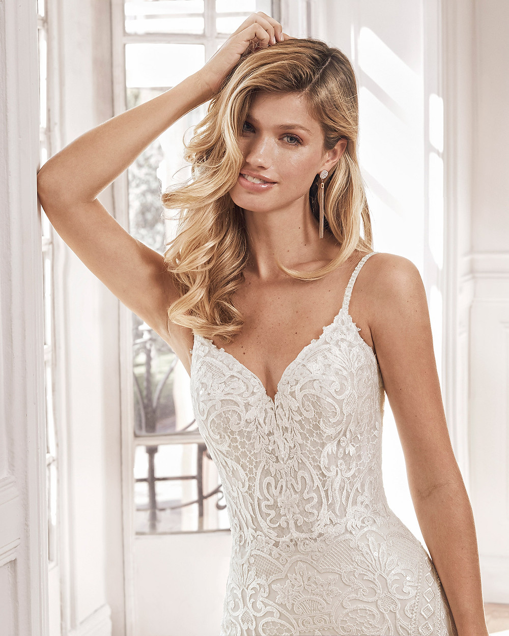 An Aire Barcelona 2020 lace mermaid fit and flare wedding dress with straps