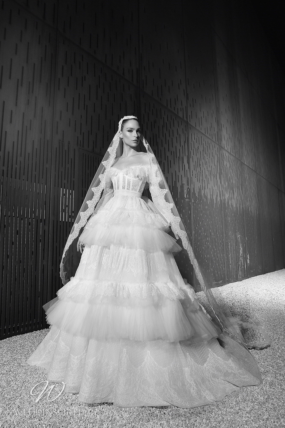 A Zuhair Murad Spring 2022 strapless tulle and lace off the shoulder ball gown wedding dress with a ruffle skirt
