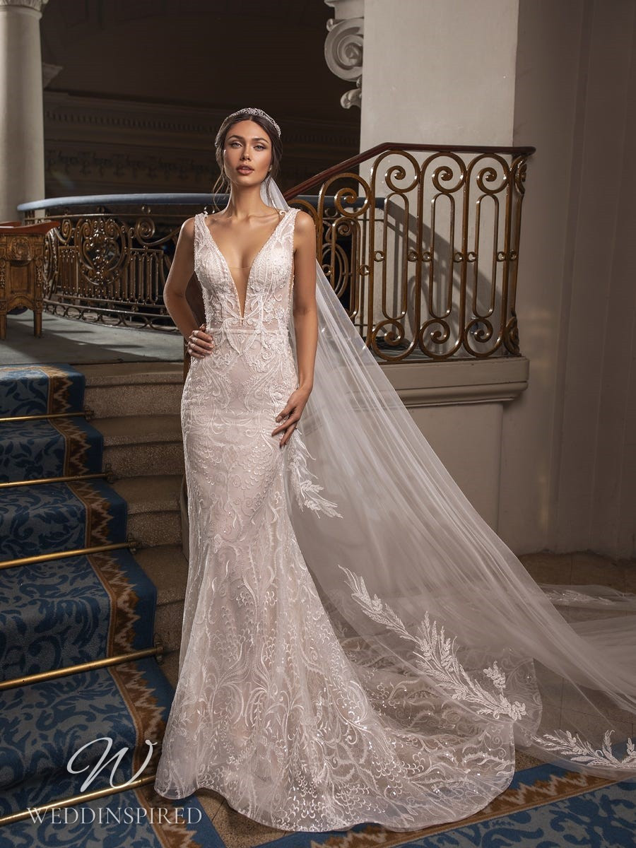 A Pronovias Privée 2021 ivory lace mermaid wedding dress with a v neck and straps