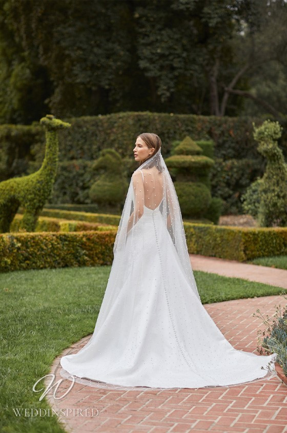 A Monique Lhuillier Bliss Fall 2021 simple satin A-line wedding dress with straps