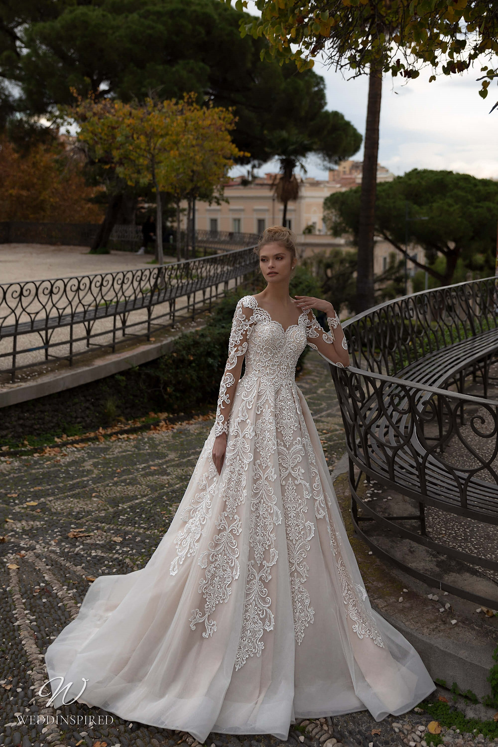A Naviblue lace A-line wedding dress with long lace sleeves