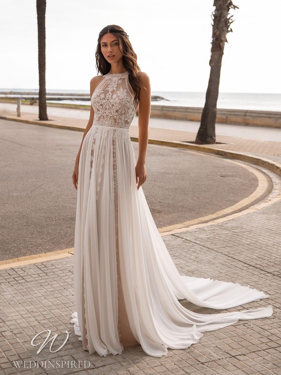A Pronovias 2021 lace boho soft flowy A-line wedding dress with a halterneck