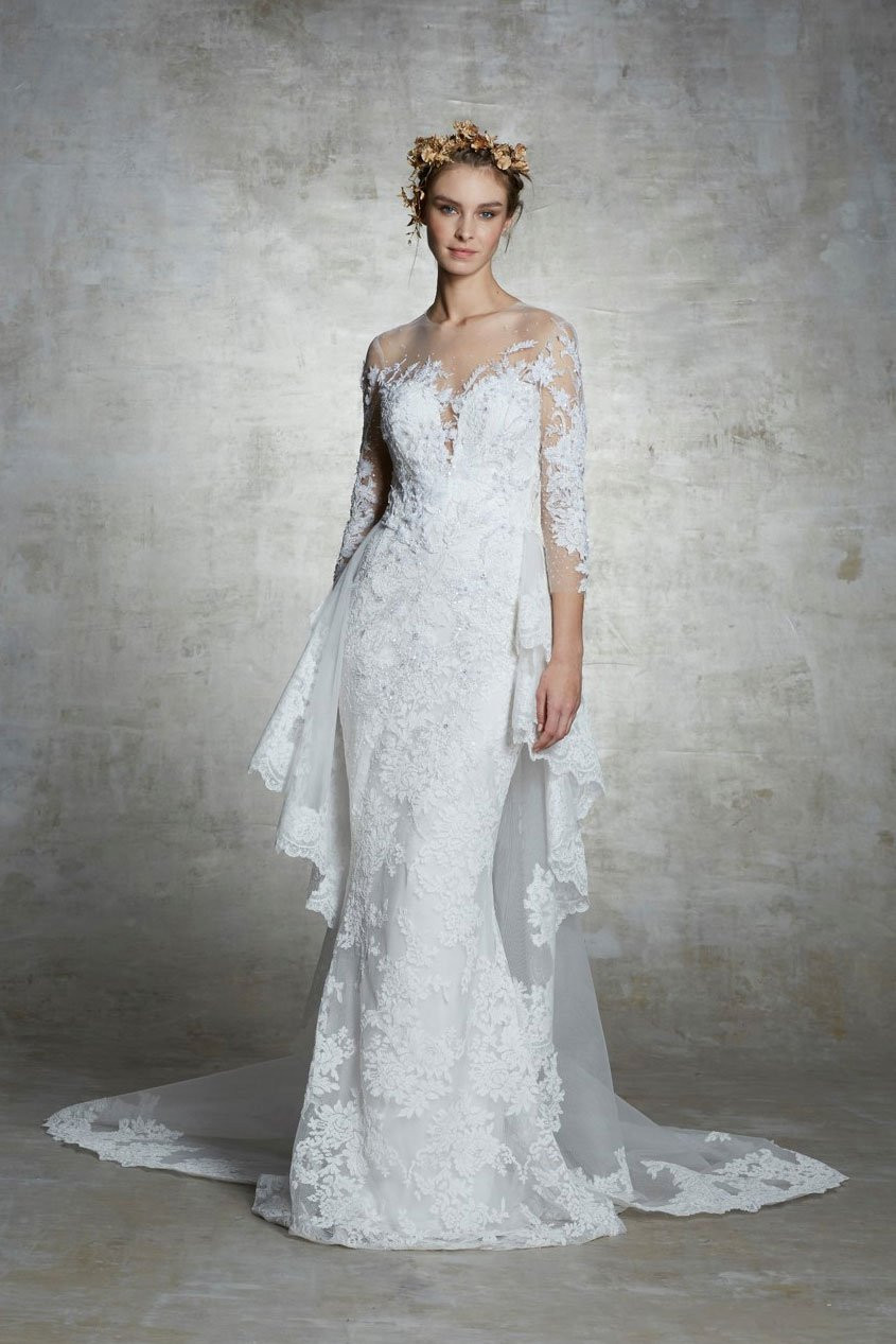 A Marchesa lace and mesh mermaid fit and flare wedding dress with long sleeves