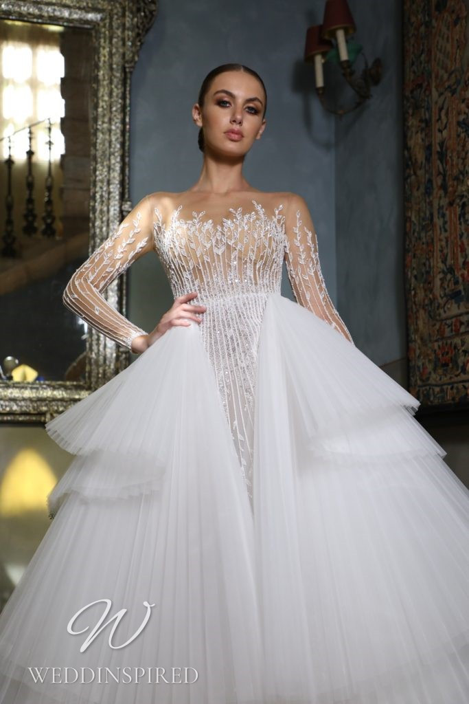 A Georges Hobeika 2021 lace and tulle princess wedding dress with long sleeves