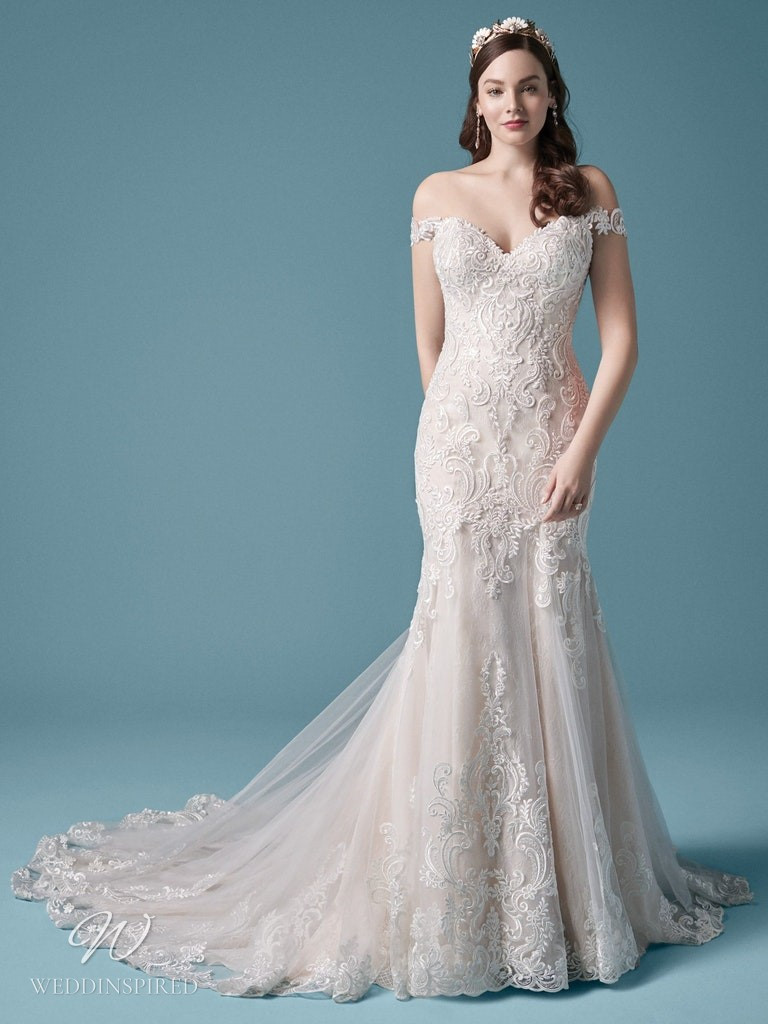 A Maggie Sottero 2021 off the shoulder lace and tulle mermaid wedding dress