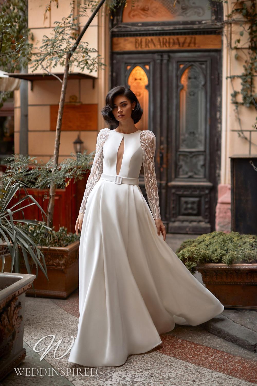 A Daria Karlozi 2021 satin A-line wedding dress with long sleeves