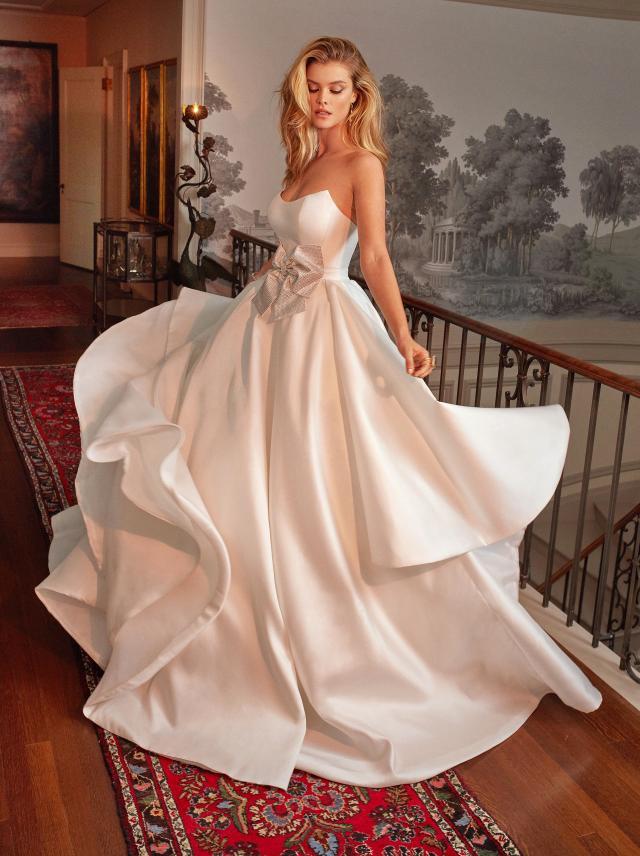 A Galia Lahav simple strapless silk ball gown wedding dress with a bow