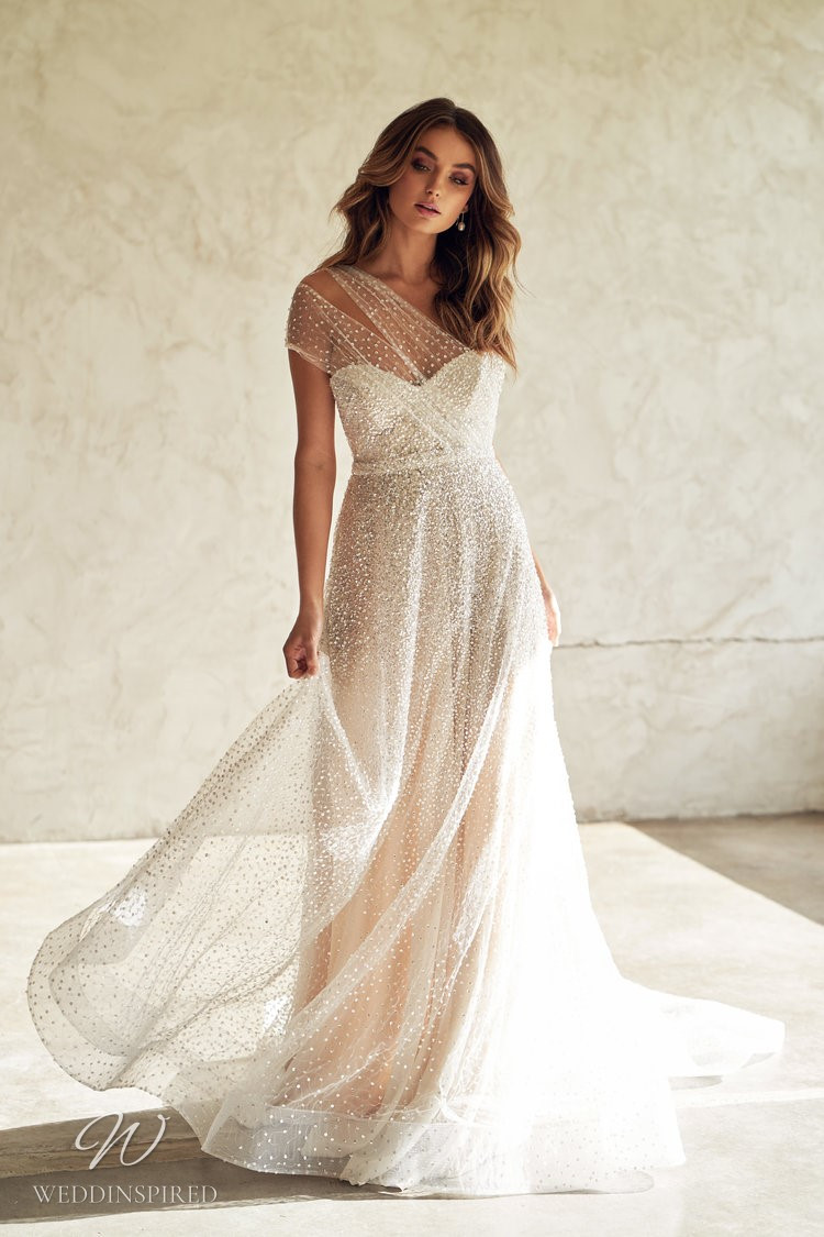 An Anna Campbell 2020 one shoulder blush A-line wedding dress with tulle and beading