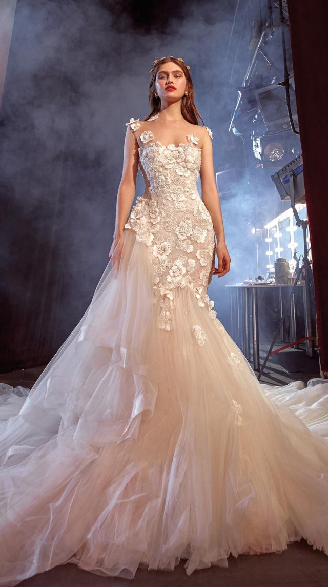 A Galia Lahav blush mermaid wedding dress, with tulle skirt and flowers