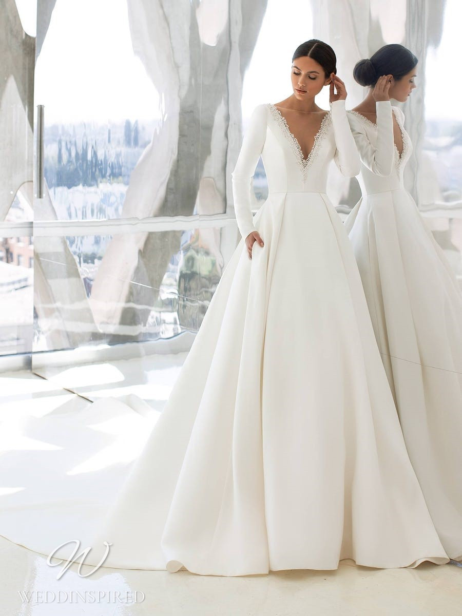 A Pronovias 2021 satin princess ball gown wedding dress with long sleeves and a v neck