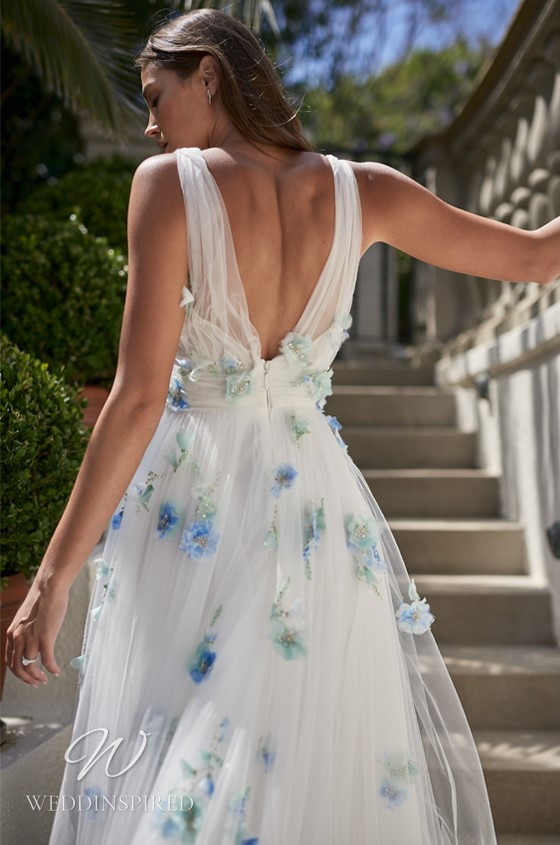 A Monique Lhuillier soft flowy chiffon A-line wedding dress with blue flowers