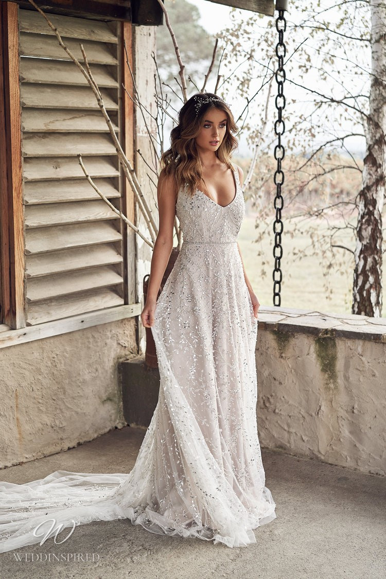 An Anna Campbell 2020 v neck A-line wedding dress with tulle, beading and crystals