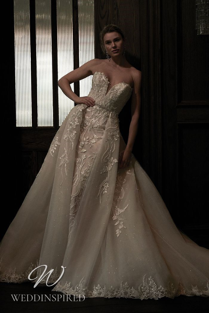 A Justin Alexander 2021 strapless lace and tulle mermaid wedding dress with a detachable skirt
