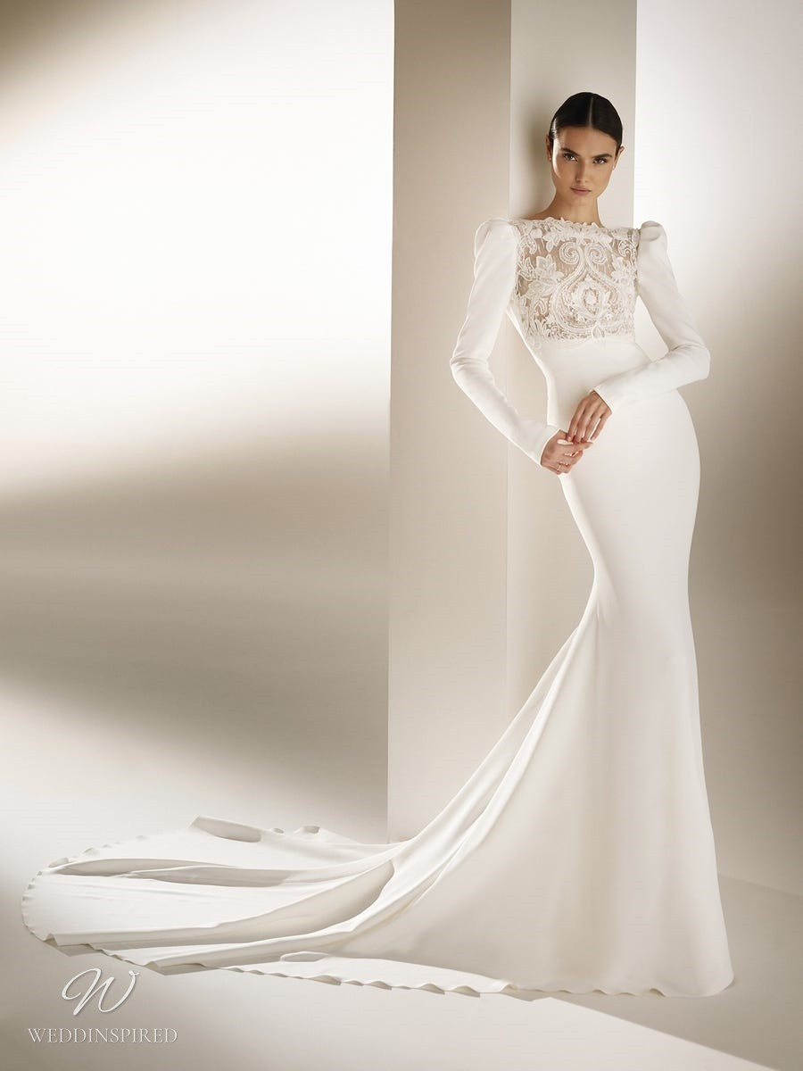 An Atelier Pronovias modest mermaid wedding dress with a high neck, lace, long sleeves and a train