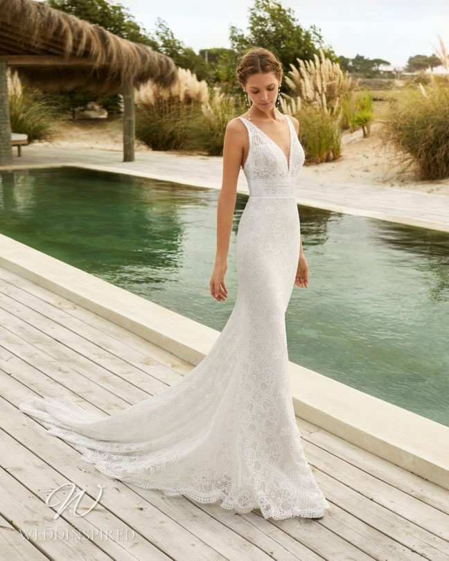 An Aire Barcelona 2021 lace mermaid wedding dress with a v neck