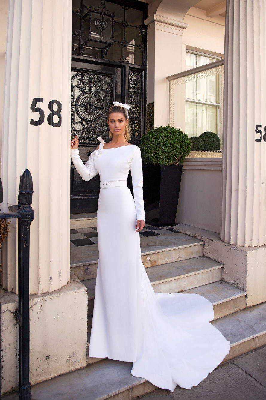 A Milla Nova simple column wedding dress with long sleeves