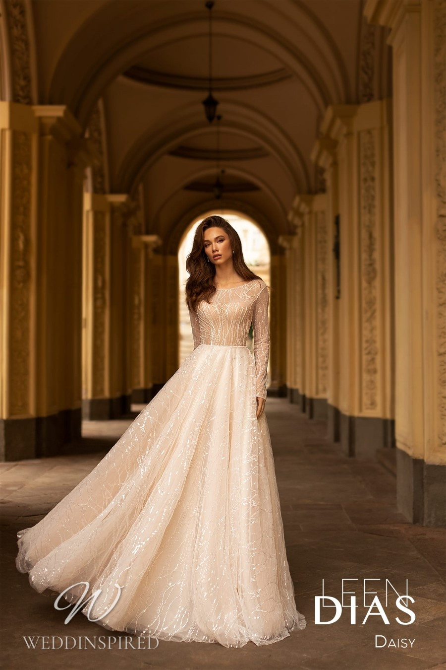 A Leen Dias 2021 modest tulle A-line wedding dress with long sleeves