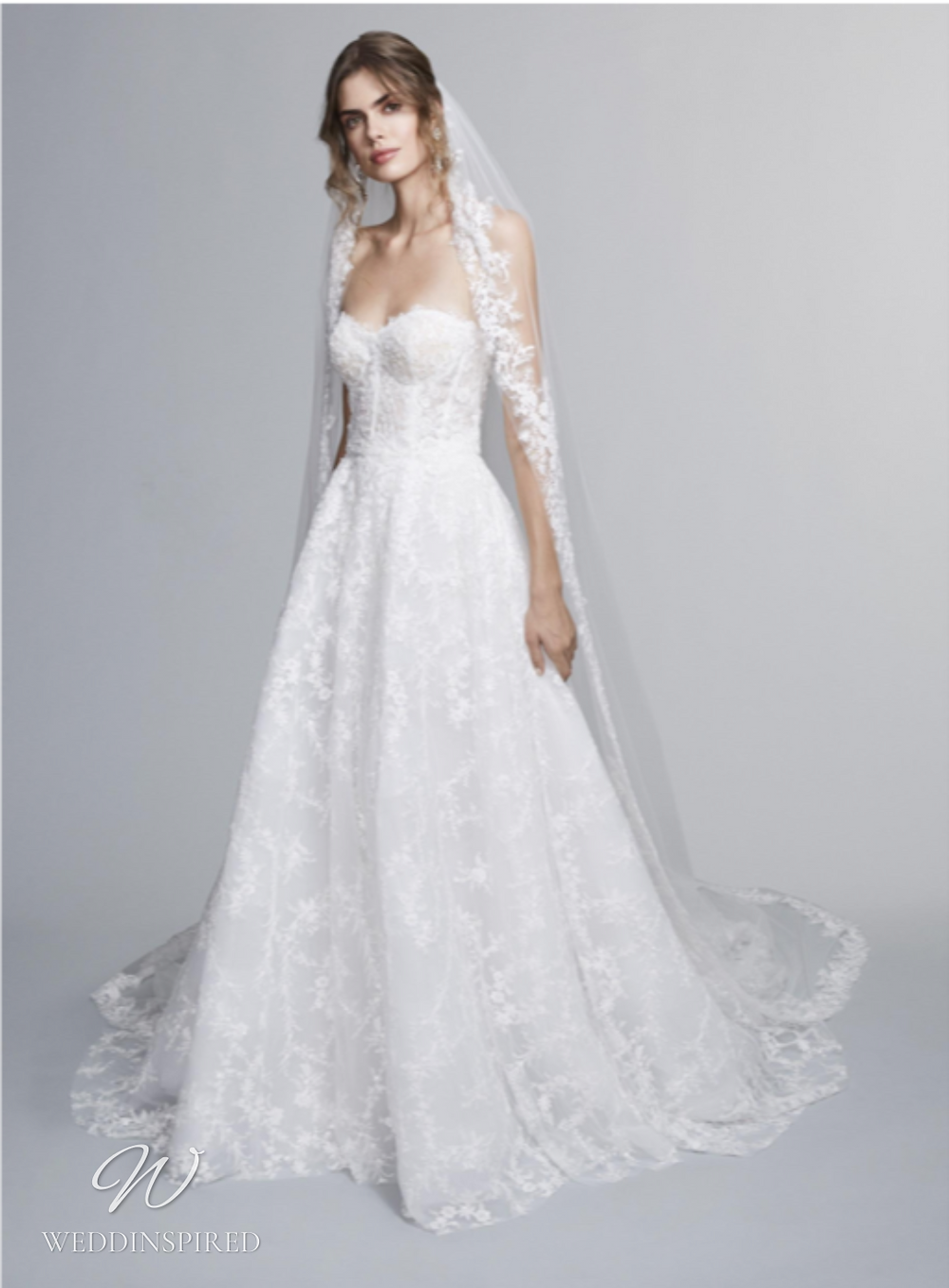 A Marchesa Notte Fall 2021 strapless romantic lace A-line wedding dress with a sweetheart neckline