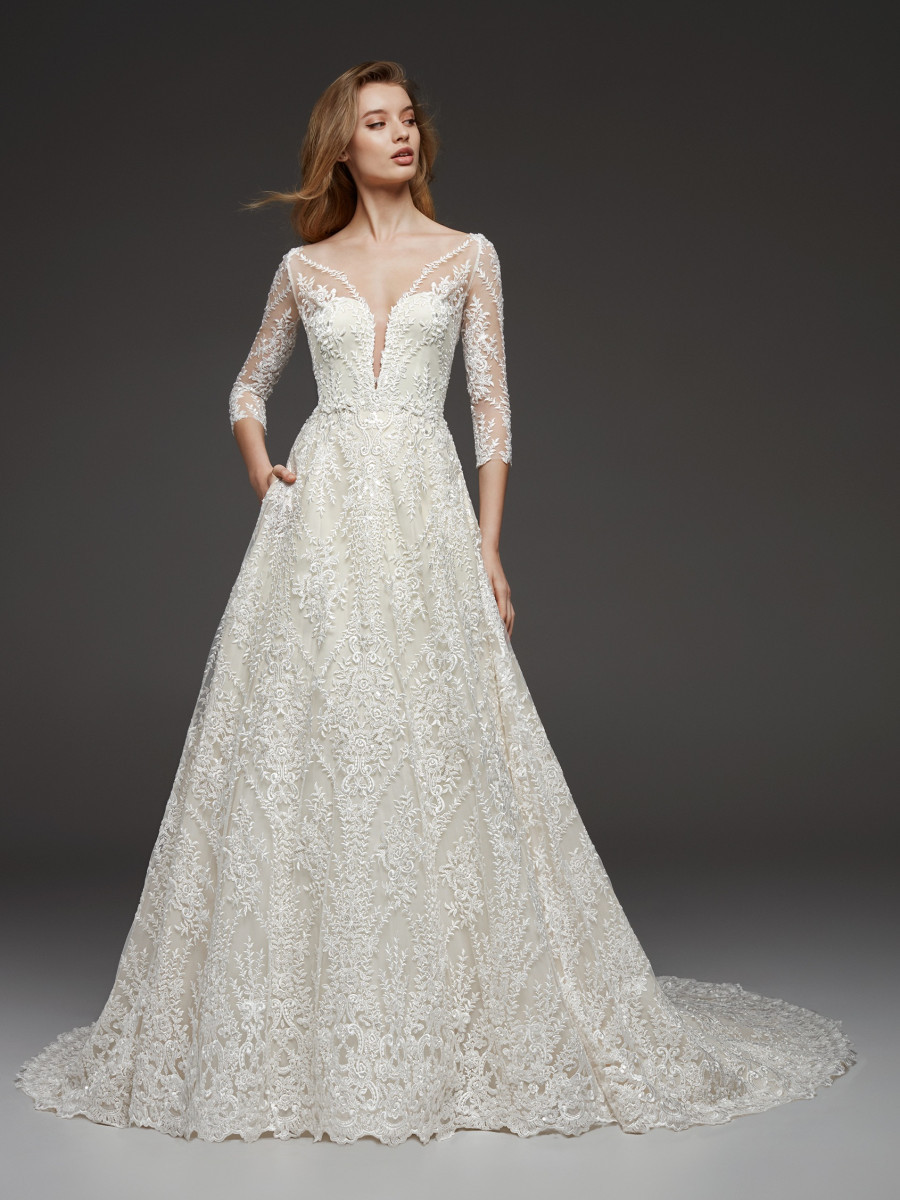A Pronovias romantic lace A-line wedding dress with pockets and mesh half sleeves