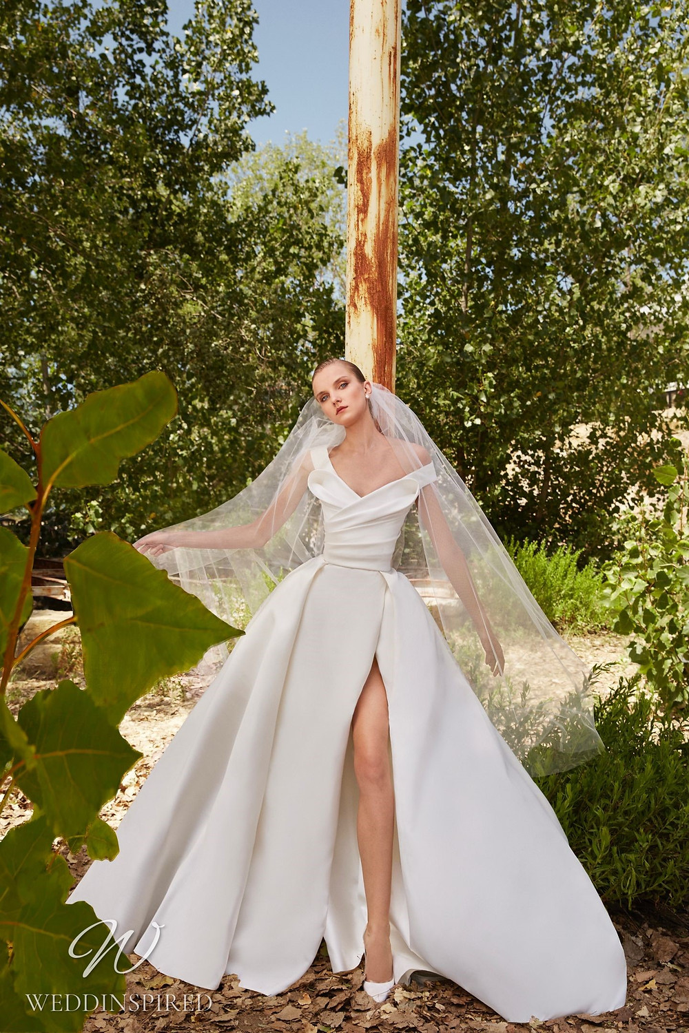 An Elie Saab Spring 2021 off the shoulder satin ball gown wedding dress with a high slit