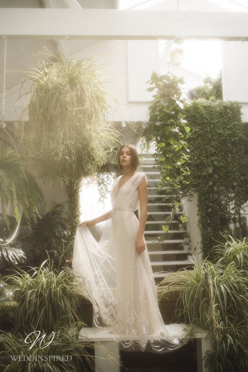 An Olwen Bourke soft flowy A-line wedding dress with an illusion overlay and a v neck