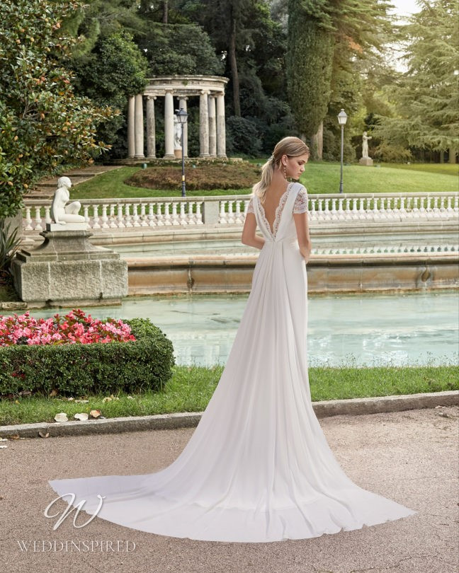 An Aire Barcelona 2021 lace and chiffon A-line wedding dress with a low back