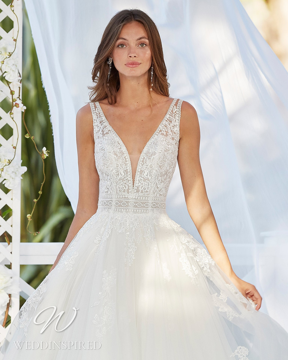 An Aire Barcelona 2021 lace and tulle princess ball gown wedding dress with a v neck