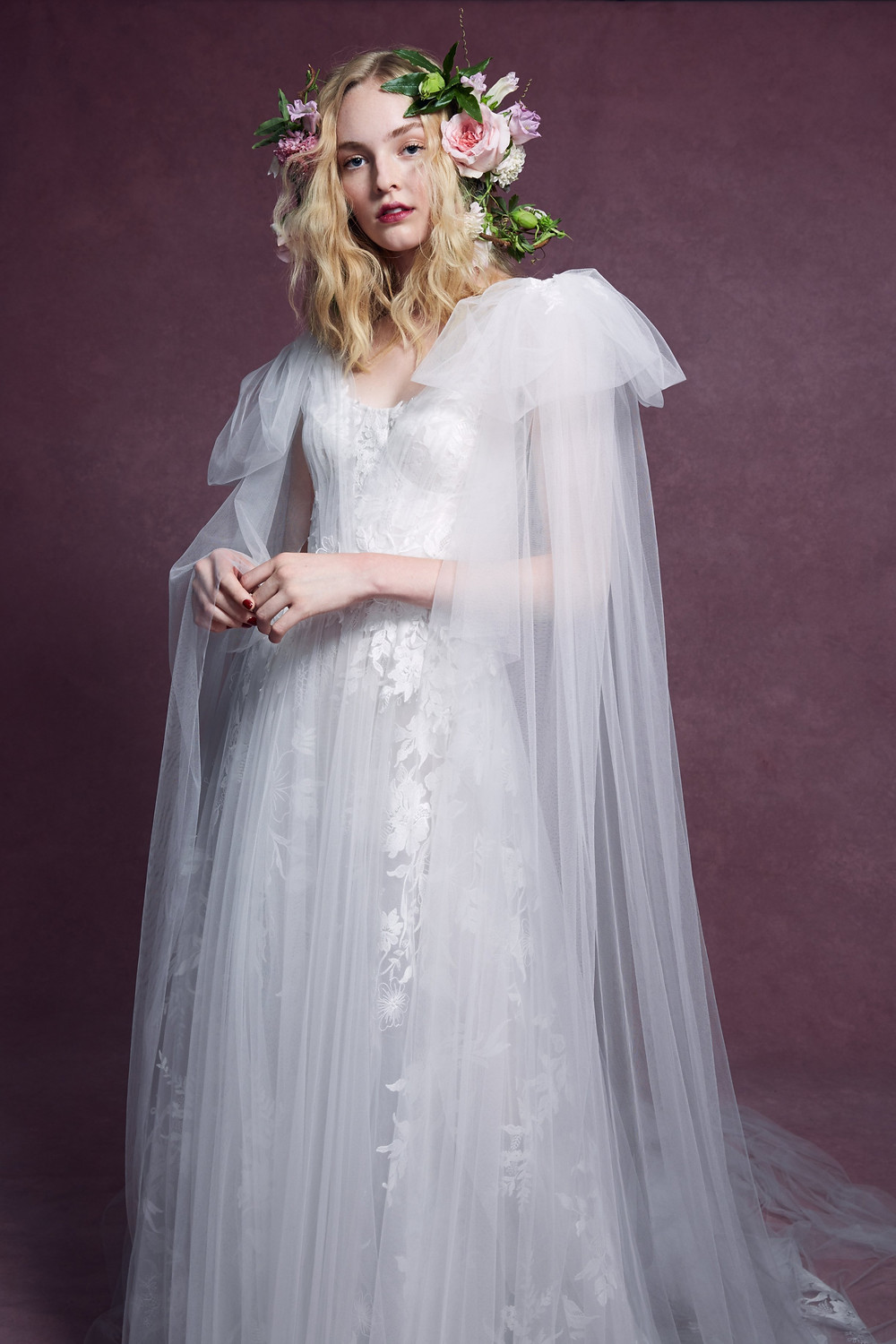 A Marchesa 2020 tulle, corset A-line wedding dress with lace that is long and flowy