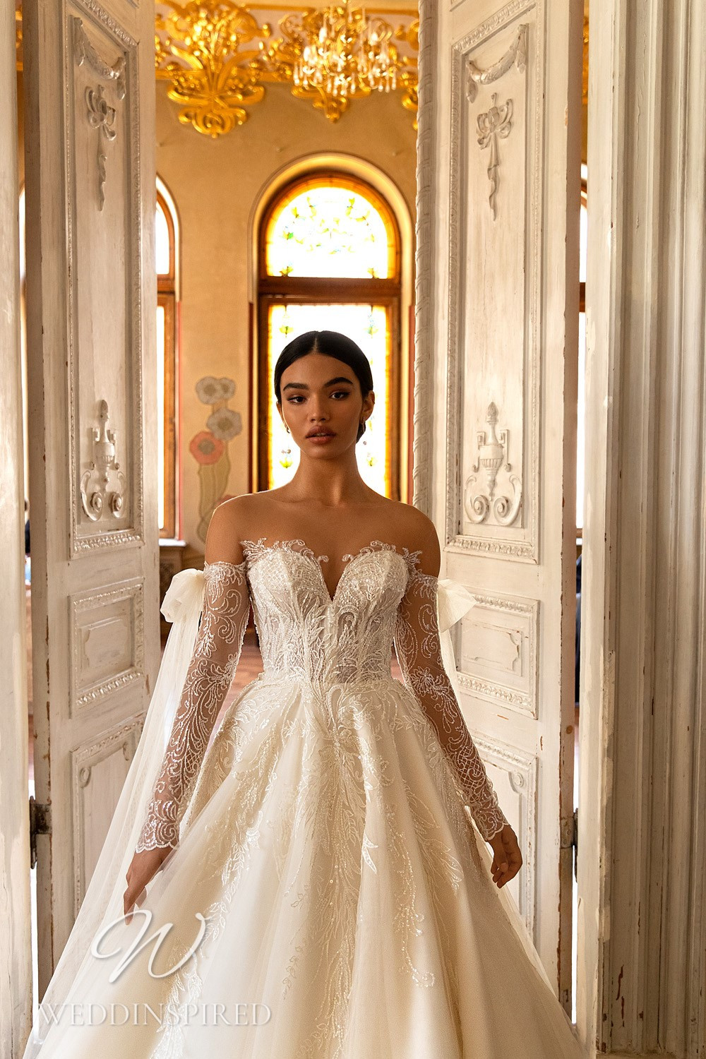 A WONÁ Concept 2021 lace off the shoulder princess wedding dress with long sleeves