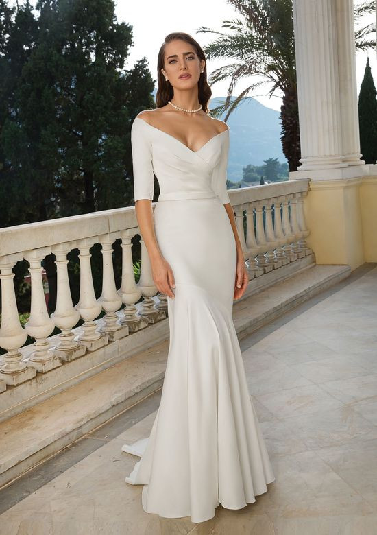 A Justin Alexander 3/4 sleeve mermaid wedding dress, with low v neckline