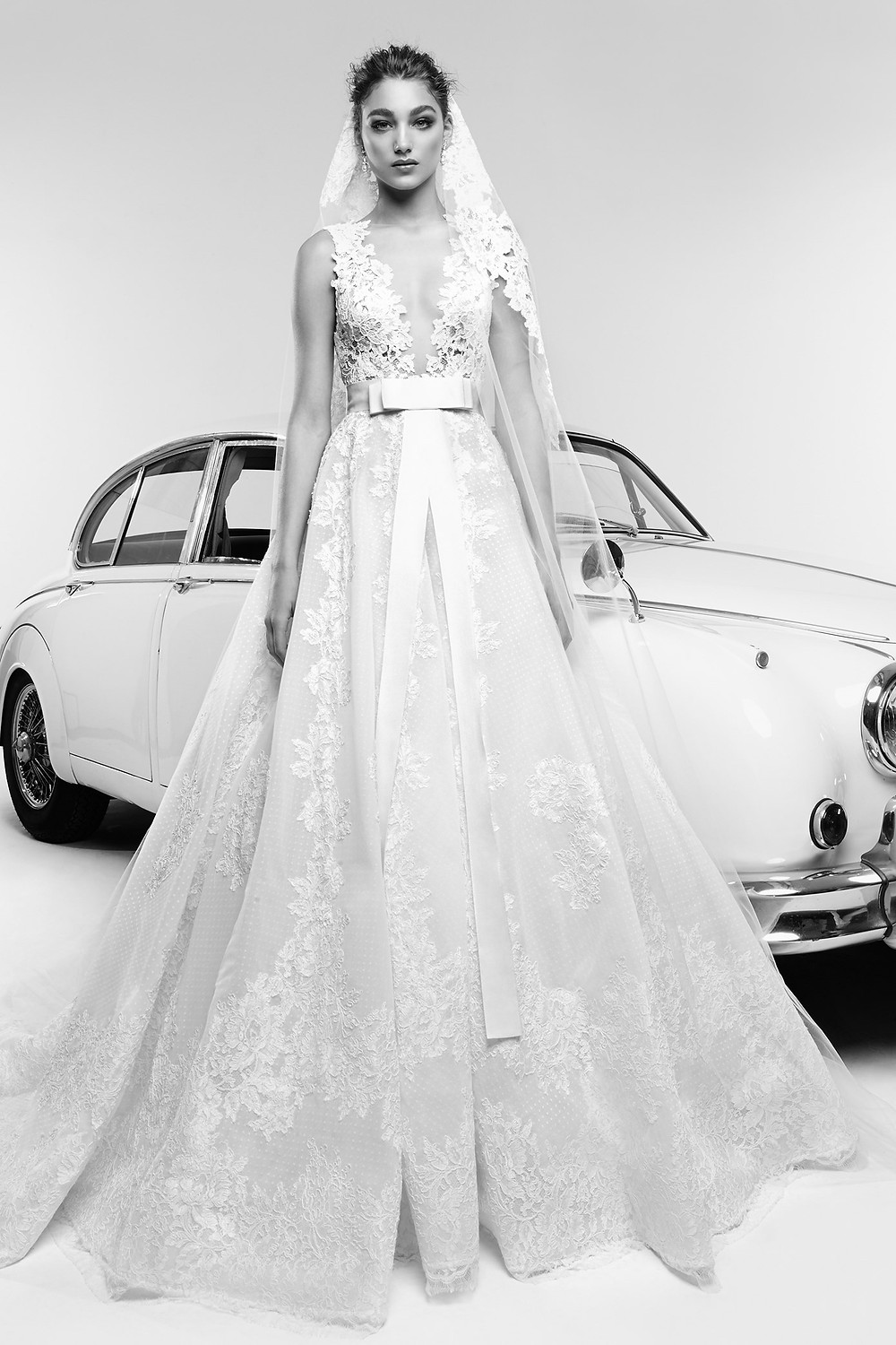 A Zuhair Murad lace and tulle A-line wedding dress with a bow
