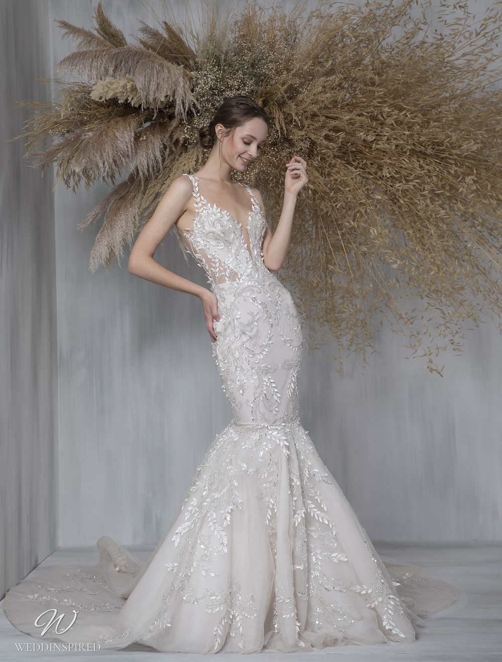 A Tony Ward 2021 lace mermaid wedding dress with straps and a train