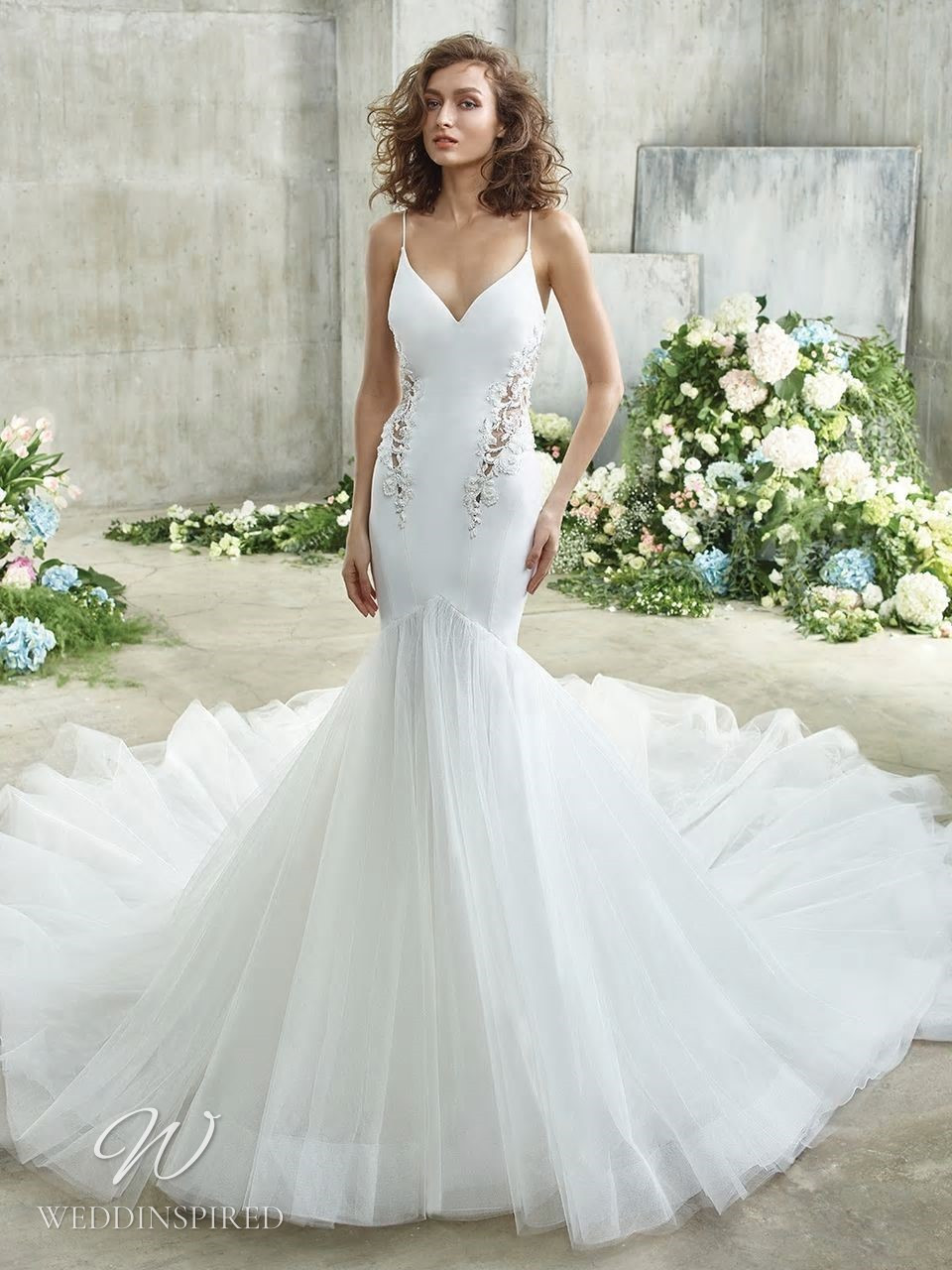 A Badgley Mischka mermaid wedding dress with a tulle skirt, lace and spaghetti straps
