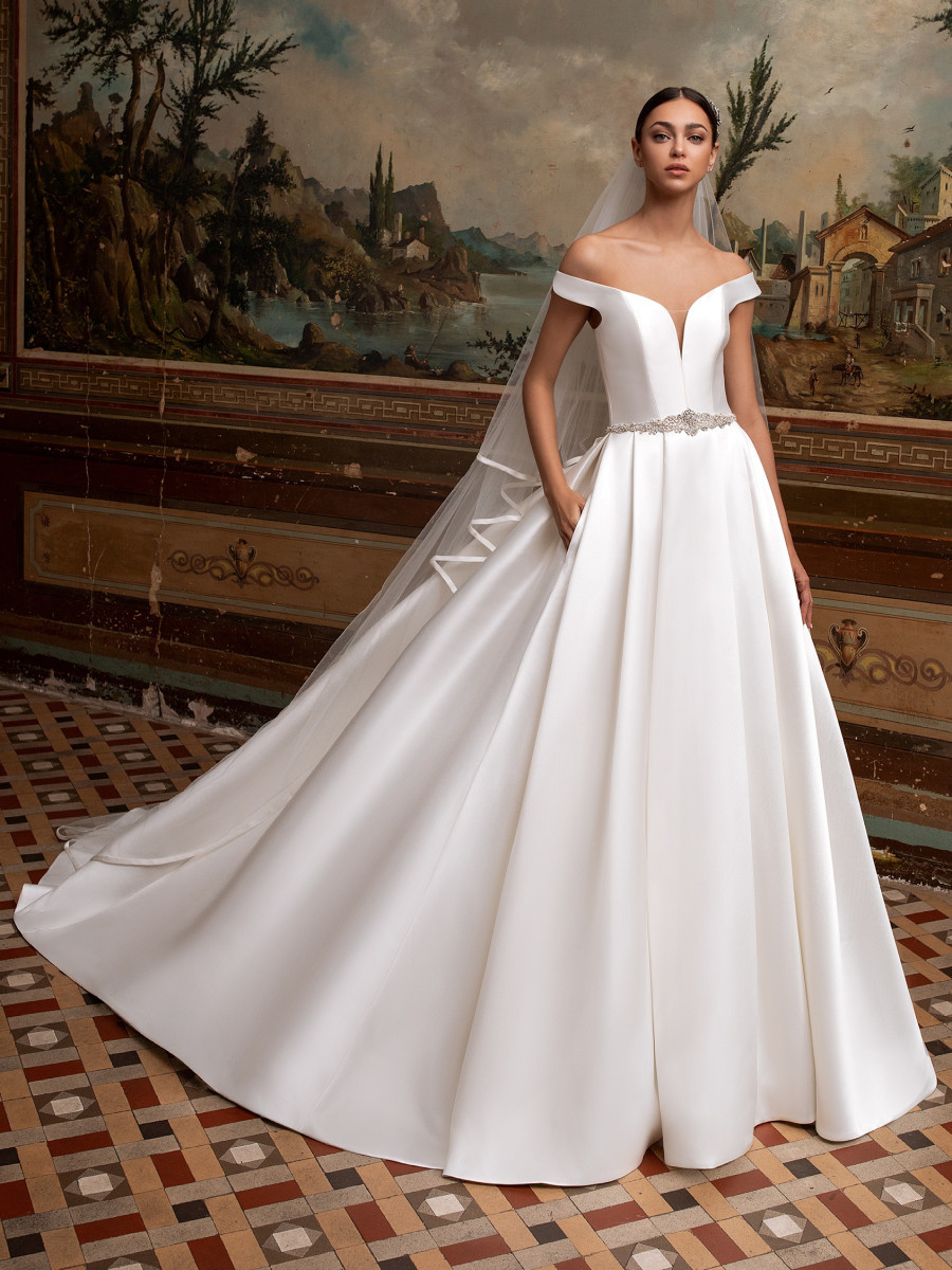 A Pronovias simple silk off the shoulder princess ball gown wedding dress with pockets
