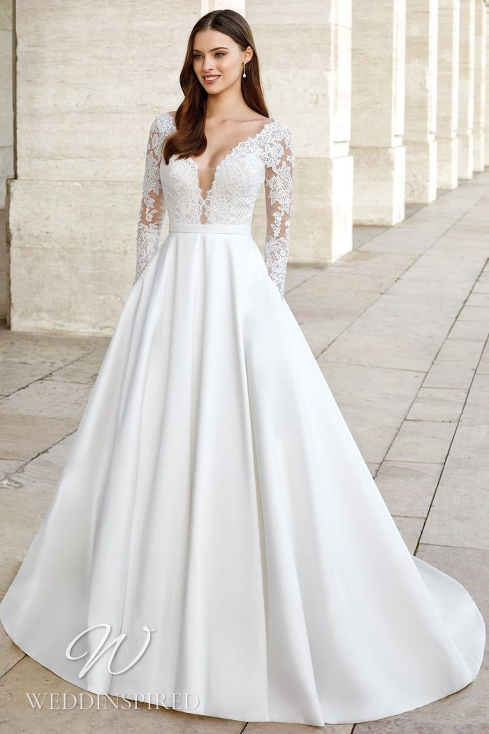 A Justin Alexander 2021 lace and silk princess wedding dress with long sleeves