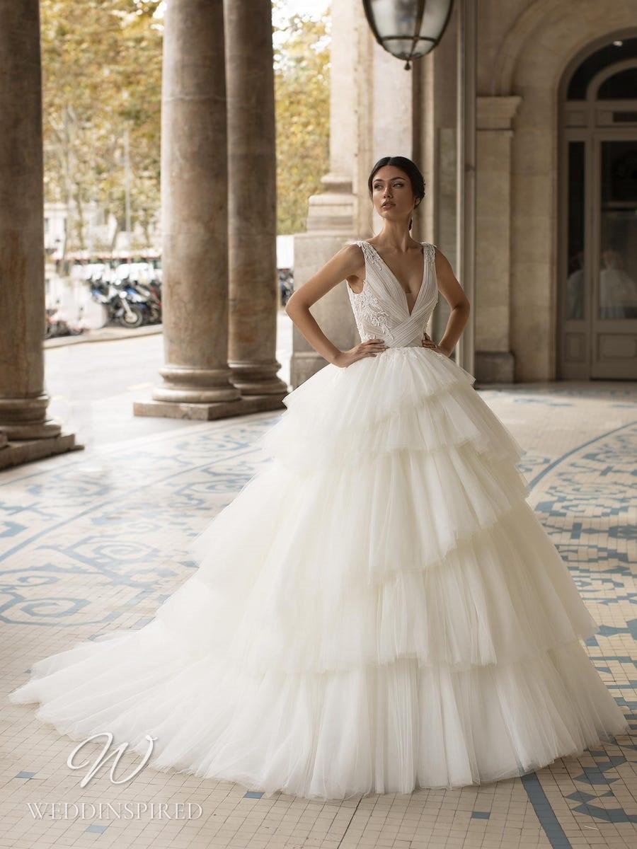 A Pronovias Privée 2021 tulle princess ball gown wedding dress with a ruffle skirt and v neckline