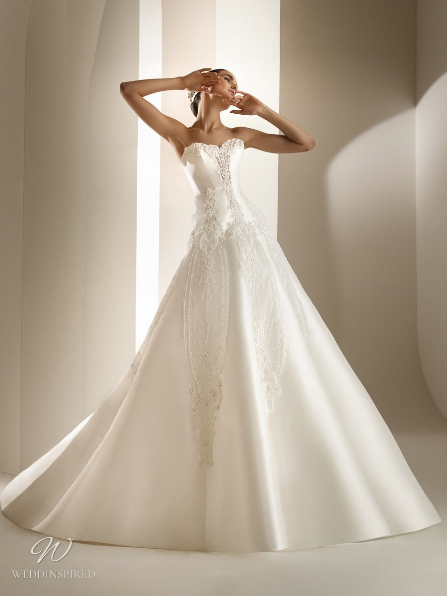 An Atelier Pronovias strapless silk princess ball gown wedding dress with sweetheart neckline and beading