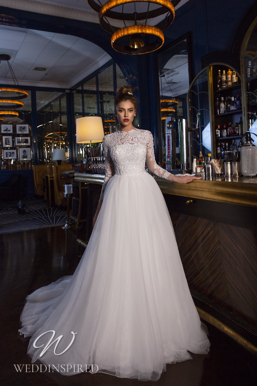 A Maks Mariano lace and tulle princess wedding dress with long sleeves
