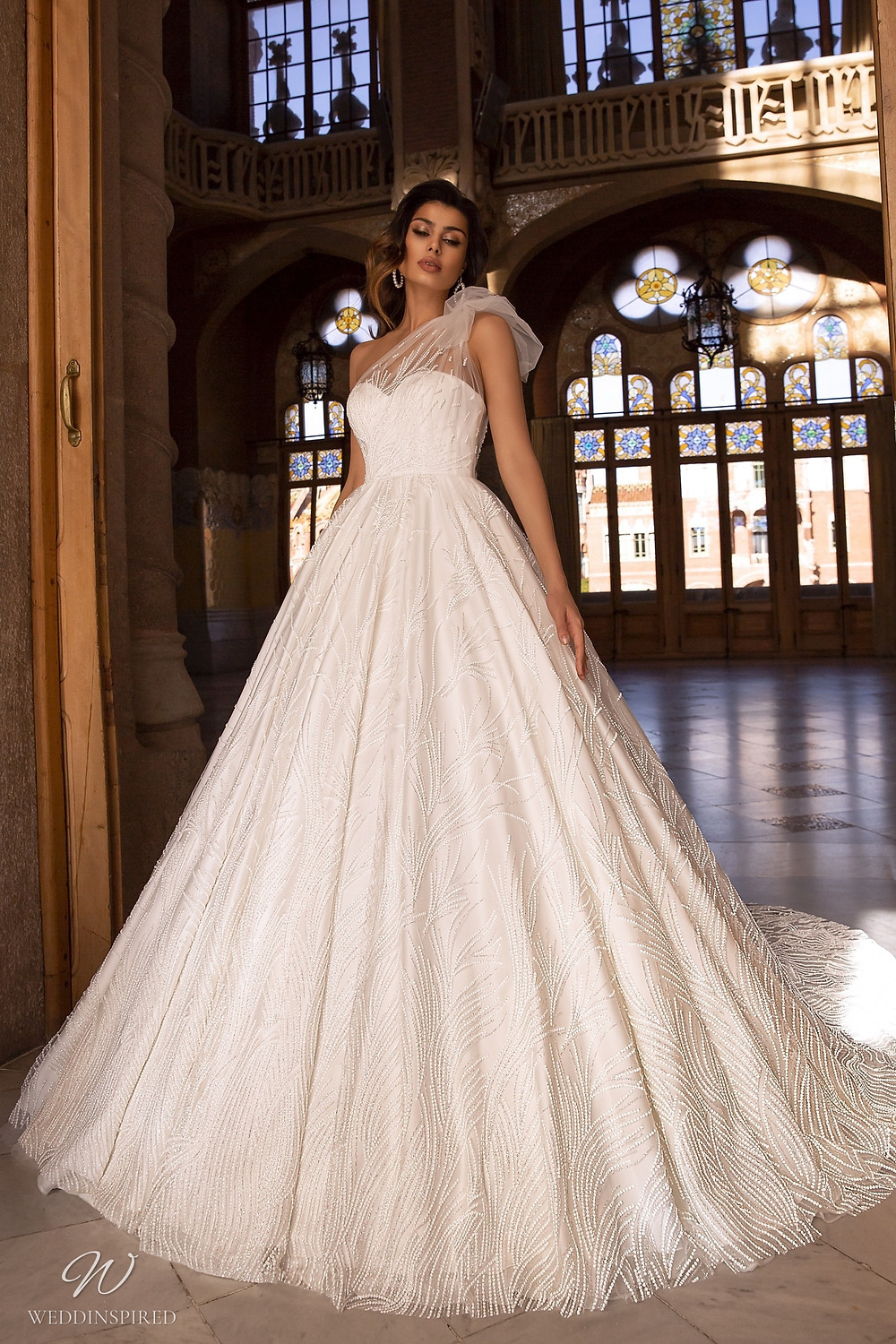 A Maks Mariano ivory sparkle princess ball gown wedding dress