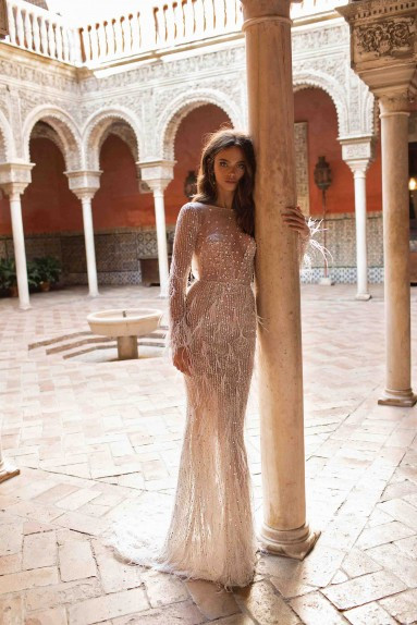 A Berta mesh, feathers and beading mermaid wedding dress with long sleeves