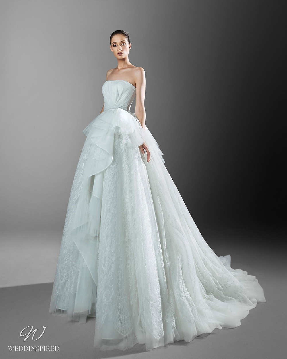 A Zuhair Murad strapless light blue princess ball gown Cinderella wedding dress with a tulle skirt