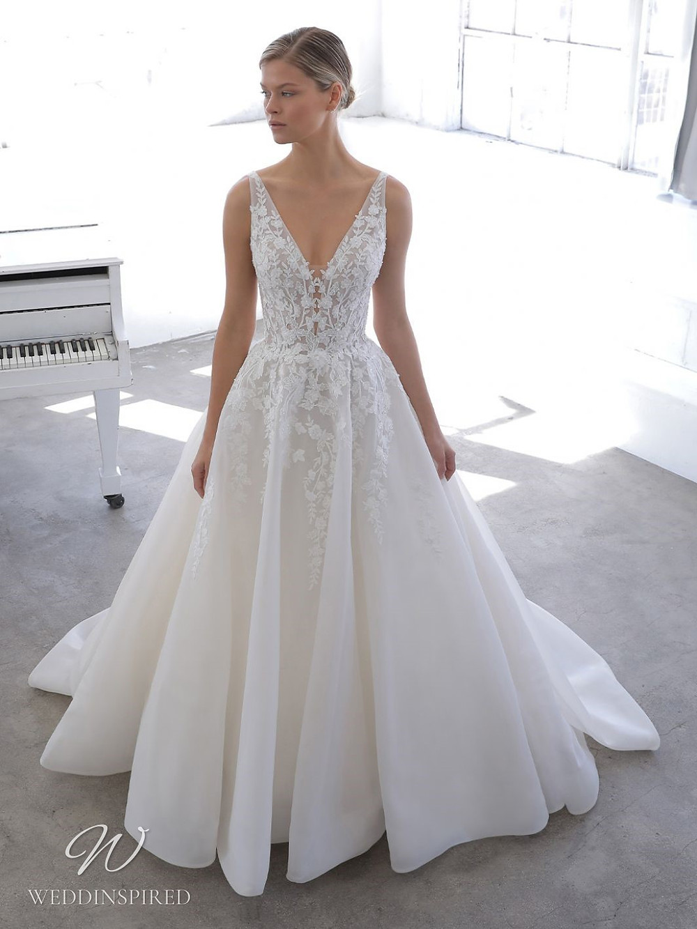 A Blue by Enzoani 2021 lace and tulle ball gown wedding dress with straps and a v neck