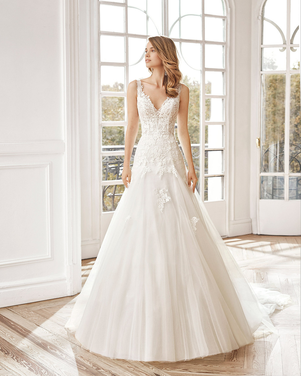 An Aire Barcelona 2020 lace and tulle A-line wedding dress with straps and a v neckline