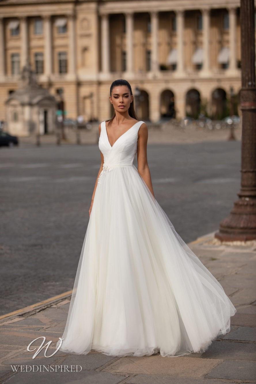 A Milla Nova tulle ball gown wedding dress with a v neckline